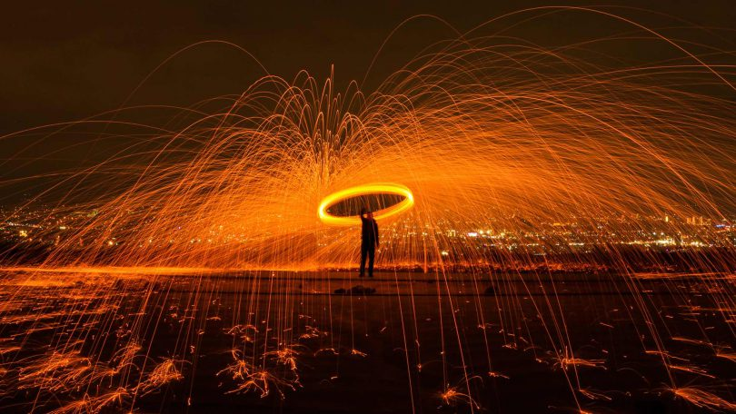 Man spinning fireworks in the dark