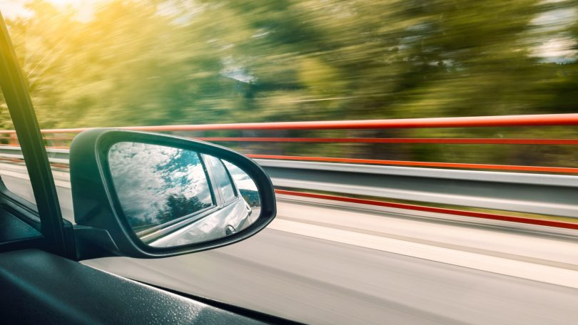 Side mirror of an accelerating car